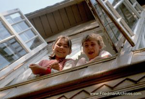 2 girls out of window