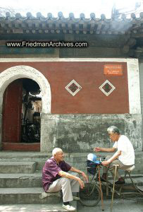 2 men in front of building