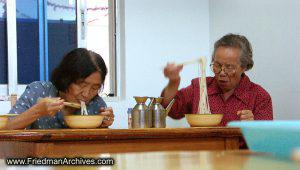 2 old ladies eating lo mein