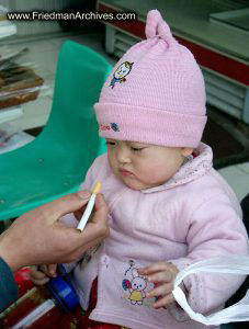 Baby and cigarette