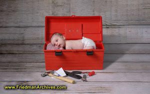 Baby in Toolbox