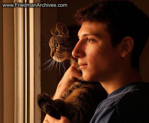 Boy and Cat at Sunrise