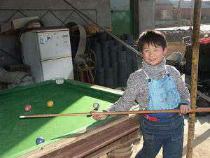 Boy playing pool
