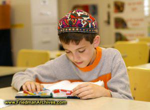 Boy with Orange Shirt Studying