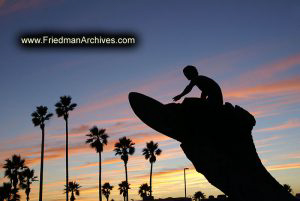 Surfer Statue and Sunset