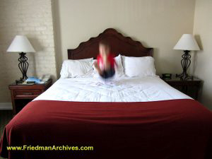 Child jumping on bed blur