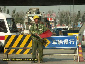 Chinese Construction Worker with Flag