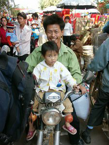Father and Daughter on Motorcycle.