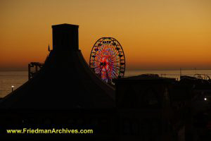 Ferris Wheel with Orange Sunset