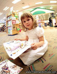 Girl Reading at Library