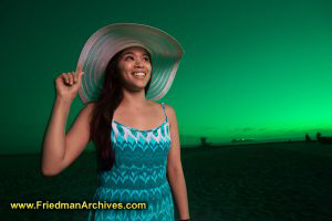 Girl with hat and Green Sky