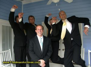Groom and jumping groomsmen