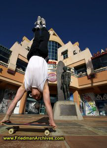 Handstand in front of Duke statue