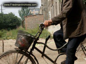 Headless Man on Bike