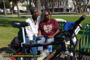 Homeless couple and a bike