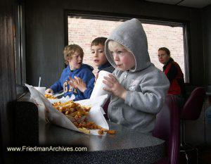 Kid eating Cheese Fries