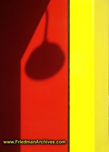 Lamp Shadow on Red and Yellow Wall
