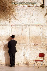 Man Standing at Wall