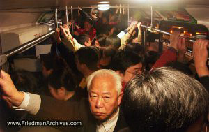 Man on crowded bus