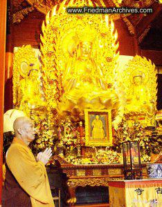 Monk Praying in Temple