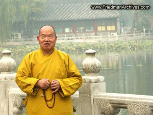 Buddhist Monk and Building
