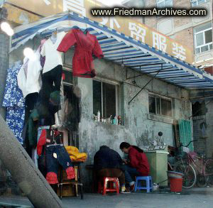 People eating under awning