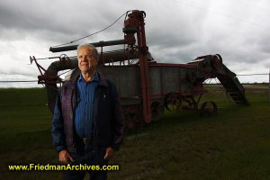 Portrait of Herman Siemens and Threshing Machine