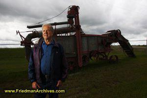 Portrait of Herman Siemens and Threshing Machine