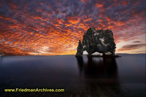 Rock and Red Sky