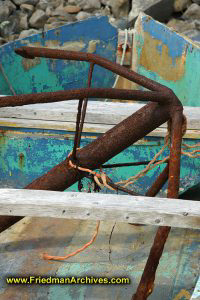 Rusty anchor in old boat