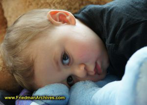 Toddler Lying on Blue Bear